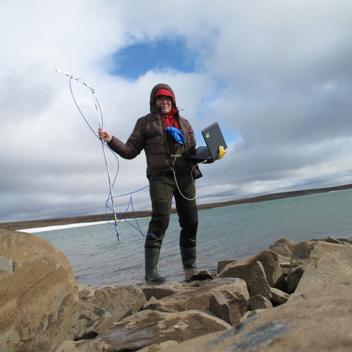 Primary Investigator Jenny Boughman preparing to record data on Þristikla, a glacial lake in the northern highlands. Copyright: Jenny Boughman