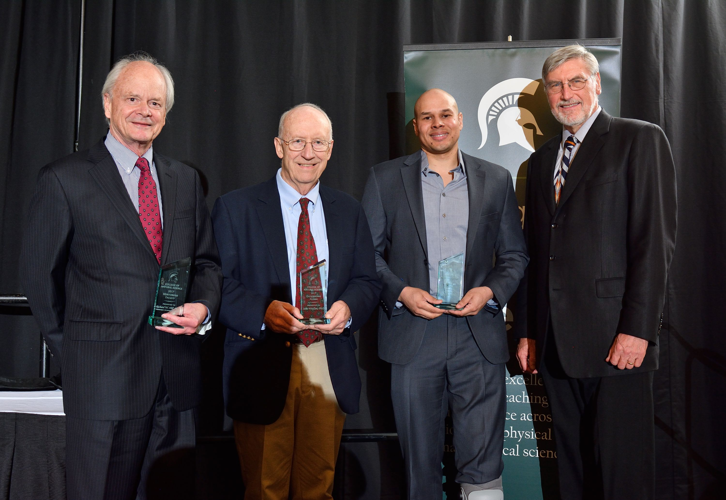 (L to R): Richard Hill, Meritorious Faculty Award winner; John Woolham, Outstanding Alumni Award winner; and Jason Pratt, Recent Alumni Award winner, pose with NatSci Dean R. James Kirkpatrick following this year's NatSci Alumni Awards dinner.