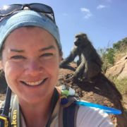 Eila Roberts with a wild primate standing in the background