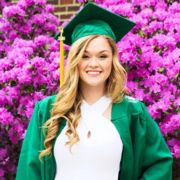 Taylor Schoen wearing graduation gown for portrait